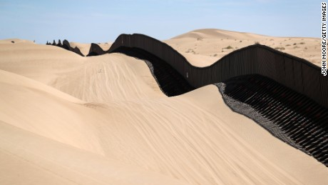 In California, part of the US-Mexico border fence snakes over sand dunes that sometimes wash over the fence.