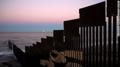 "In Tijuana, Mexico, the fence stretches into the Pacific Ocean. On November 14, 2016, a ""supermoon"" set behind the US-Mexico border fence during its closest orbit to Earth since 1948."