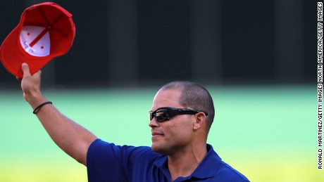 "ARLINGTON, TX - APRIL 23:  Ivan ""Pudge"" Rodriguez tips his Texas Rangers hat during a retirement ceremony before a game against the New York Yankees at Rangers Ballpark in Arlington on April 23, 2012 in Arlington, Texas.  (Photo by Ronald Martinez/Getty Images)"