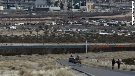 "A military convoy pass near the Mexico-US border fence, on the Mexican side, separating the towns of Anapra, Mexico and Sunland Park, New Mexico, Wednesday, Jan. 25, 2017.  U.S. President Donald Trump says his administration will be working in partnership in Mexico to improve safety and economic opportunity for both countries and will have ""close coordination"" with Mexico to address drug smuggling. It will set in motion the construction of his proposed border wall, a key promise from his 2016 campaign. (AP Photo/Christian Torres)"