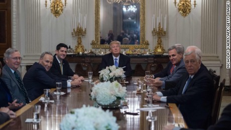 US President Donald Trump smiles during a reception with Congressional leaders, including Senate Majority Leader Mitch McConnell (L), Senate Minority Leader Chuck Schumer (2nd L) and House Speaker Paul Ryan (3rd L), House Minority Whip Steny Hoyer (R) and Majority Leader Kevin McCarthy on January 23, 2017 at the White House in Washington, DC. / AFP / NICHOLAS KAMM        (Photo credit should read NICHOLAS KAMM/AFP/Getty Images)