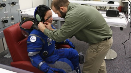 Boeing unveils new, blue spacesuits