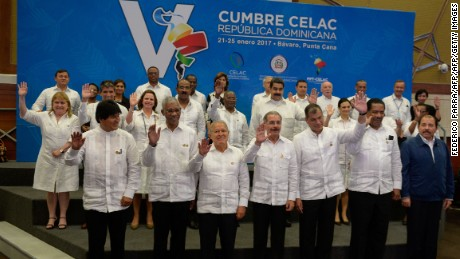 Presidents and representatives wave during the family picture of the Fifth Summit of the Community of Latin American and Caribbean States (CELAC) in Bavaro, Dominican Republic, on January 25, 2017.  Latin American and Caribbean leaders gather Wednesday to discuss regional trade, migration and drug policies in an uncertain new era of foreign relations under new US President Donald Trump. / AFP / FEDERICO PARRA        (Photo credit should read FEDERICO PARRA/AFP/Getty Images)