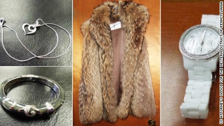 Pictured is a fur coat  and jewelry that cashier Cynthia Mills is accused of purchasing after she allegedly embezzled $9.5 million from her former employer.