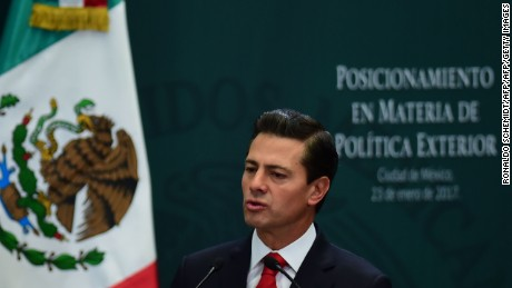 "Mexican President Enrique Pena Nieto gives a foreign policy speech after US President Donald Trump vowed to start renegotiating North American trade ties, in Mexico City on January 23, 2017. Trump's vows to scrap the North American Free Trade Agreement to protect US jobs have raised concern in Mexico, which sends most of its exports to the United States. Pena Nieto's office said he congratulated Trump on taking office in a phone call Saturday and that both had agreed to open a ""new dialogue."" / AFP / Ronaldo SCHEMIDT        (Photo credit should read RONALDO SCHEMIDT/AFP/Getty Images)"