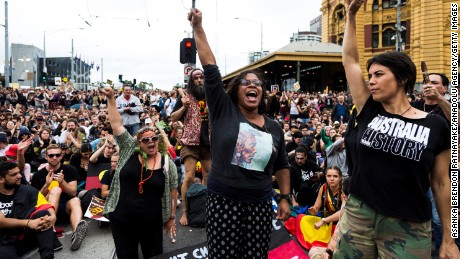 Australian Actress Shareena Clanton raises her hand during a protest organized by Aboriginal rights activists on Australia Day in Melbourne, Australia on January 26, 2017.