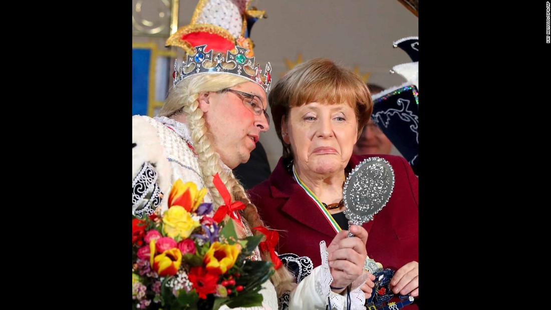 German Chancellor Angela Merkel, right, attends a reception for carnival clubs at the Chancellery in Berlin on Monday, January 23.