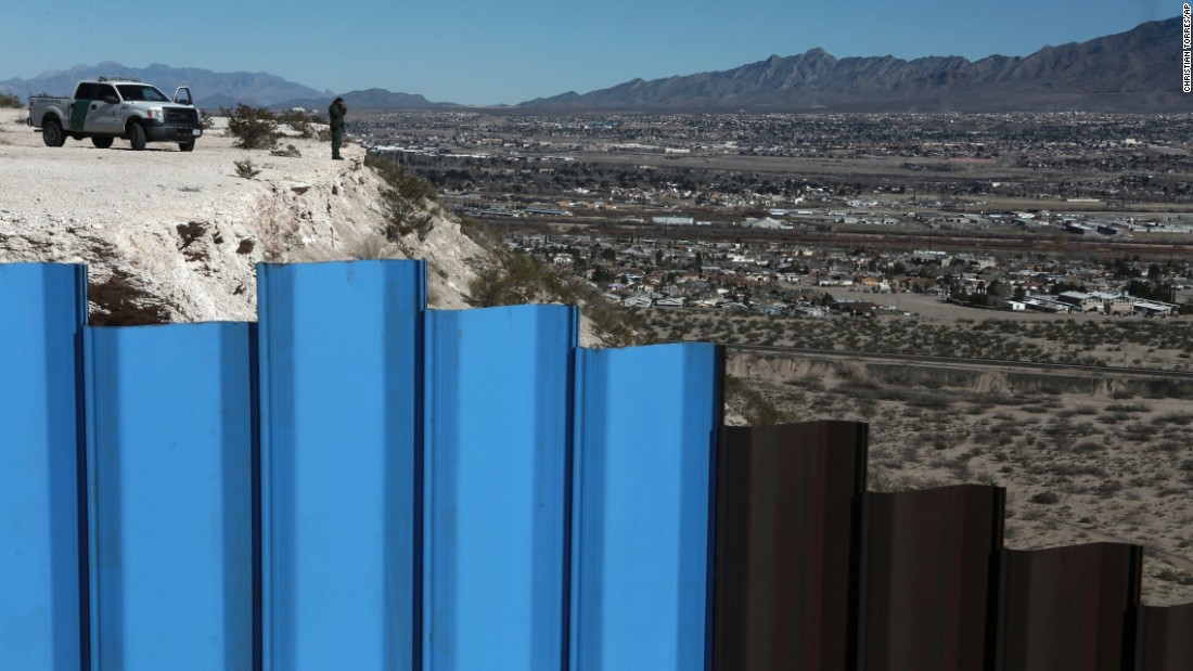 "A border-patrol agent stands near a fence separating Juarez, Mexico, from Sunland Park, New Mexico, on Wednesday, January 25. US President Donald Trump <a href=""http://www.cnn.com/2017/01/25/politics/donald-trump-build-wall-immigration-executive-orders/index.html"" target=""_blank"">has promised to build a border wall </a>between Mexico and the United States."