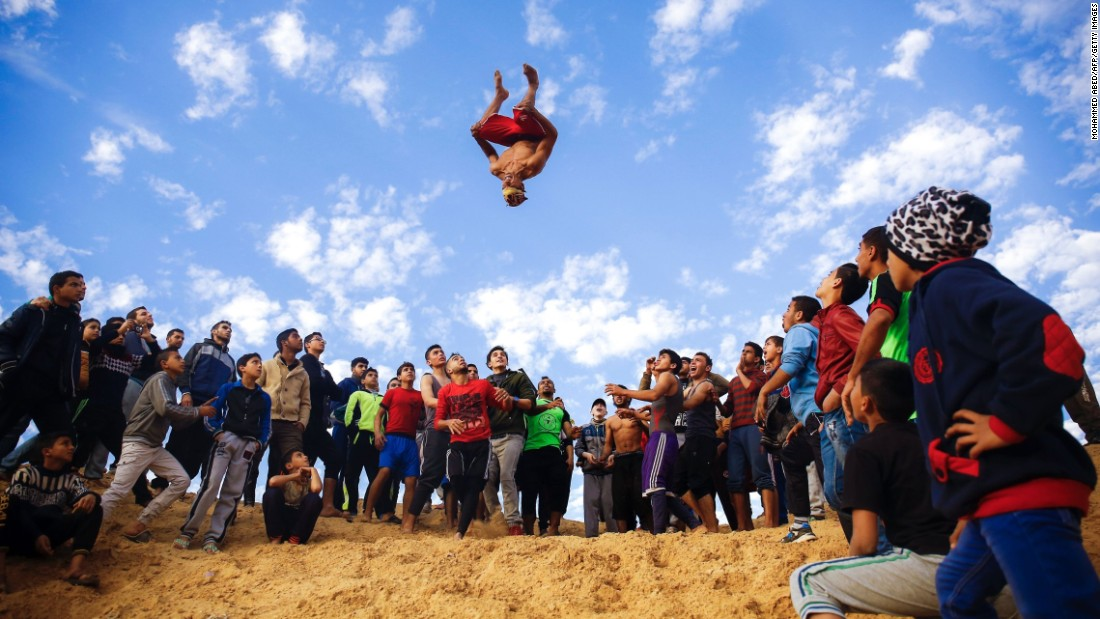 Young Palestinians from Gaza's Free Parkour team practice their parkour skills in Gaza City on Friday, January 20. Parkour is an extreme sports discipline where people leap and hurdle through urban environments.