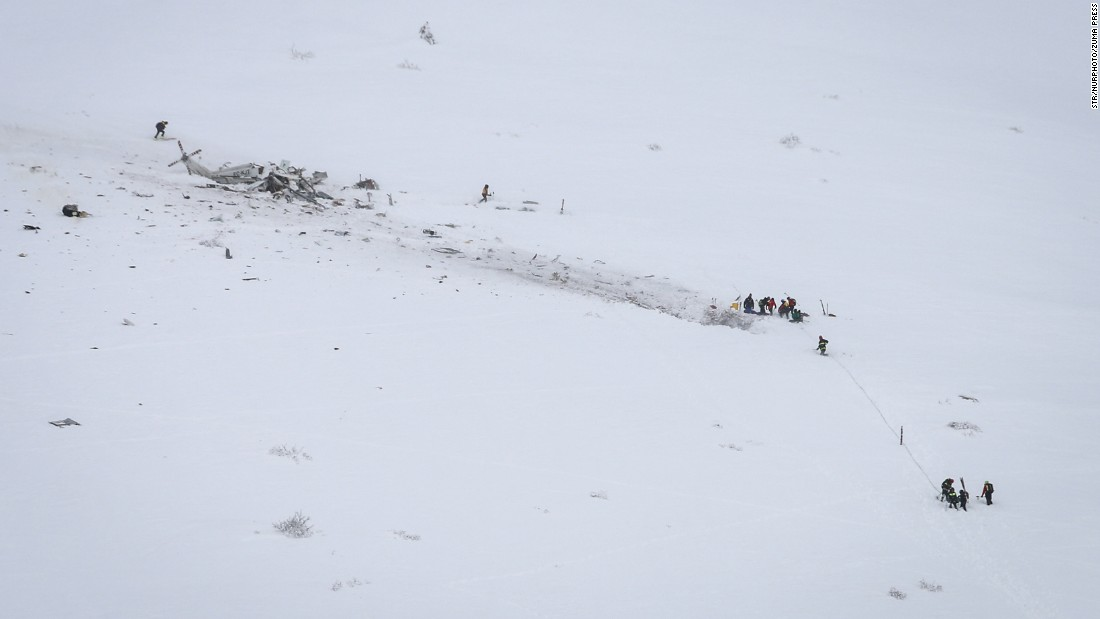 "Rescuers work at the scene of <a href=""http://www.cnn.com/2017/01/24/europe/italy-helicopter-crash/"" target=""_blank"">a helicopter crash in central Italy</a> on Tuesday, January 24. At least six people were killed in the crash, which happened near the ski resort of Campo Felice in the province of L'Aquila. The helicopter was a rescue helicopter on its way to help an injured skier."