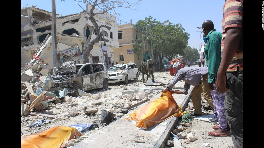 "A man checks the body of a victim at the site of a suicide attack in Mogadishu, Somalia, on Wednesday, January 25. The extremist group Al-Shabaab claimed responsibility for <a href=""http://www.cnn.com/2017/01/25/africa/mogadishu-somalia-blast/index.html"" target=""_blank"">two explosions</a> that police say killed at least 21 people. At least 50 people were injured."