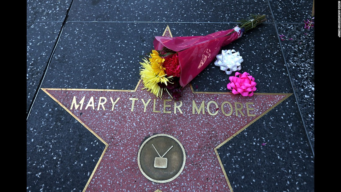 "Flowers sit on the Hollywood Walk of Fame after the death of actress Mary Tyler Moore on Wednesday, January 25. Moore, whose 1970s TV show helped usher in a new era for women on television, was 80 years old. <a href=""http://www.cnn.com/2017/01/25/entertainment/gallery/mary-tyler-moore/index.html"" target=""_blank"">See photos from her life and career</a>"