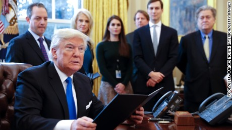 WASHINGTON, DC - JANUARY 24: President Donald Trump signs one of five executive orders related to the oil pipeline industry in the Oval Office of the White House January 24, 2017 in Washington, DC. Looking on are White House Chief of Staff Reince Priebus, counselor to the President Kellyanne Conway, White House Communications Director Hope Hicks, Senior Advisor Jared Kushner (2nd R) and Senior Counselor Stephen Bannon (R). (Photo by Shawn Thew-Pool/Getty Images)