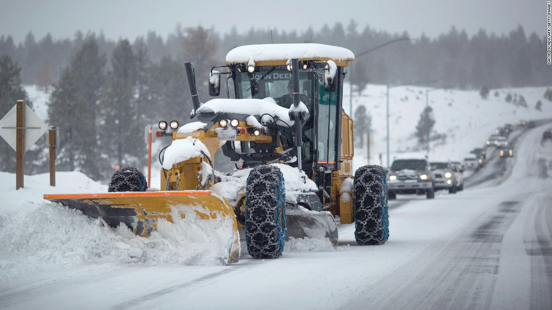 A grader plows snow near Mammoth Lakes, California, on Monday, January 9.
