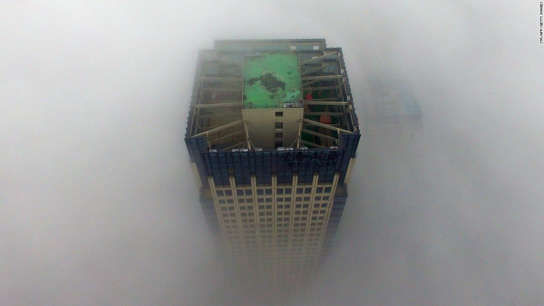 "A thick layer of fog envelops a building in Zhengzhou, China, on Monday, January 2. China issued its <a href=""http://www.cnn.com/2017/01/03/asia/china-fog-alert/"" target=""_blank"">first-ever red alert for fog</a> in a number of northern and eastern regions. That followed some 24 cities issuing red alerts for air pollution. Red is the most serious level in the country's warning system.<br />"