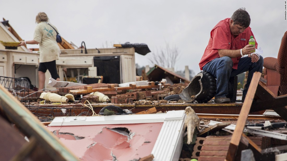 "Jeff Bullard sits in what used to be the foyer of his home as his daughter, Jenny, looks through debris in Adel, Georgia, on Sunday, January 22. <a href=""http://www.cnn.com/2017/01/22/us/gallery/severe-storms-in-georgia/index.html"" target=""_blank"">Severe storms hit southern Georgia</a> that weekend.<br />"