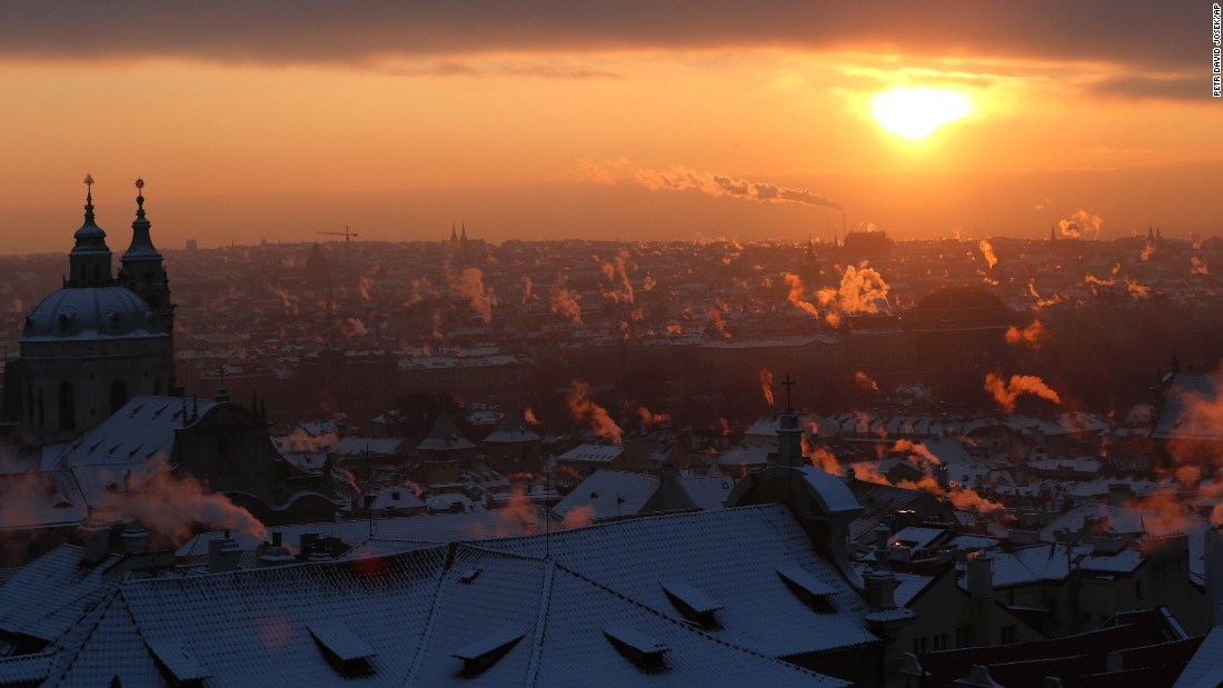 Smoke rises from chimneys during a cold morning in Prague, Czech Republic, on Wednesday, January 11.