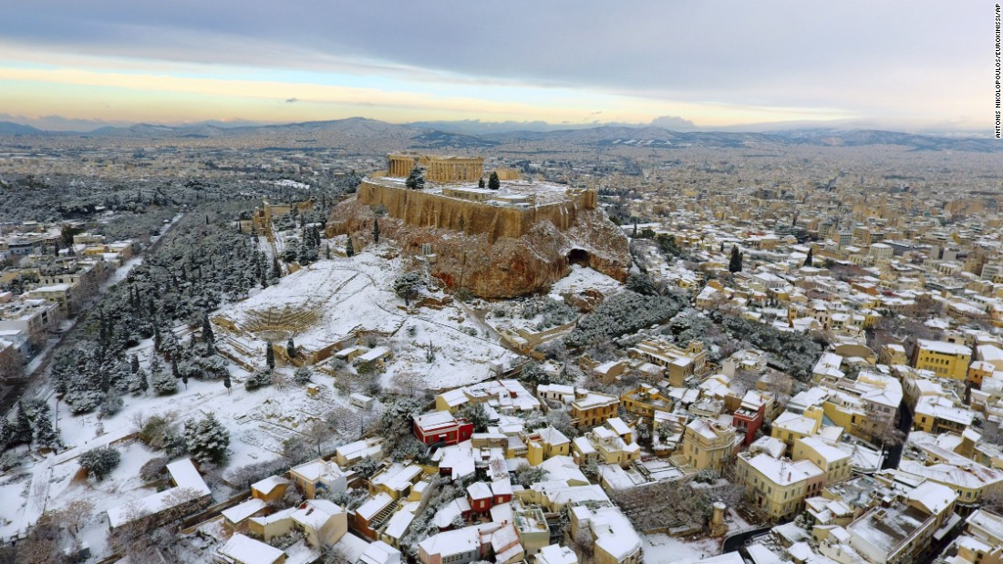 The Parthenon is seen atop the snow-covered Acropolis hill in Athens, Greece, on Tuesday, January 10.