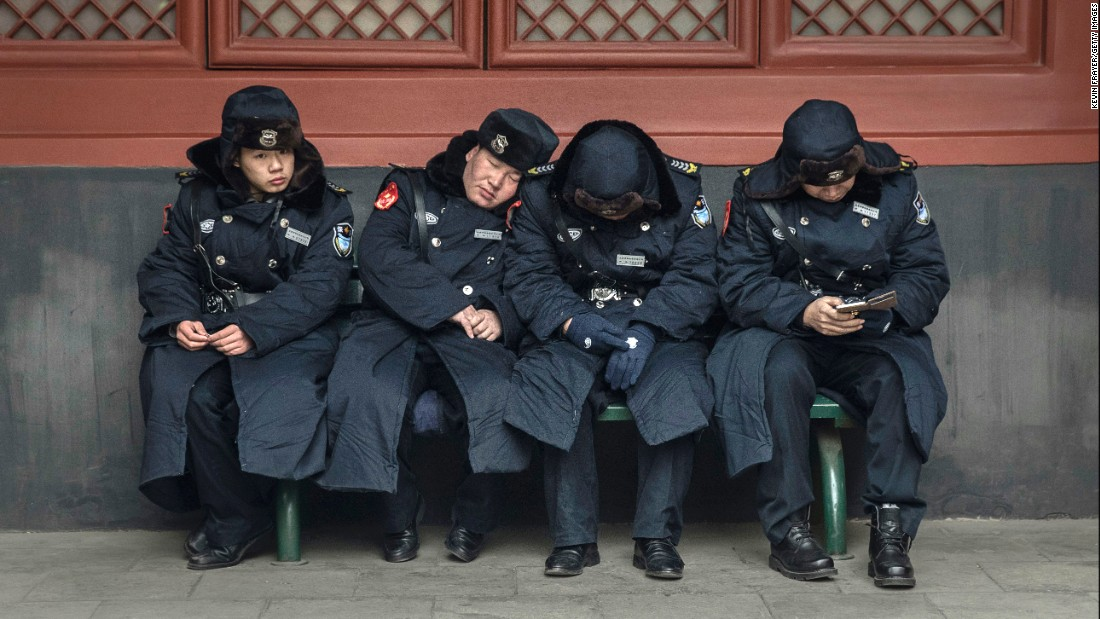 Security guards take a break on the first day of the Lunar New Year at the Yonghe Temple in Beijing.