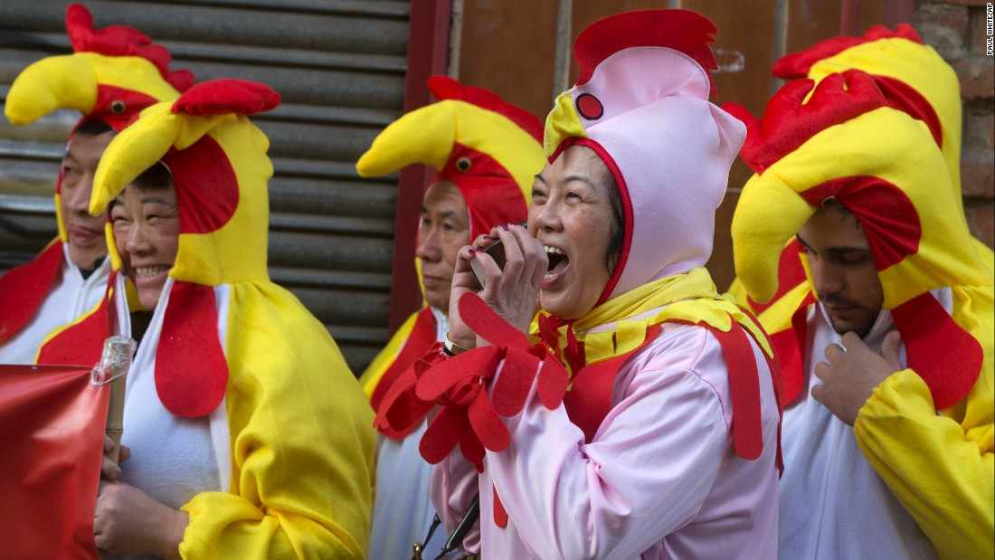 Revelers in Madrid, Spain, celebrate the year of the rooster.