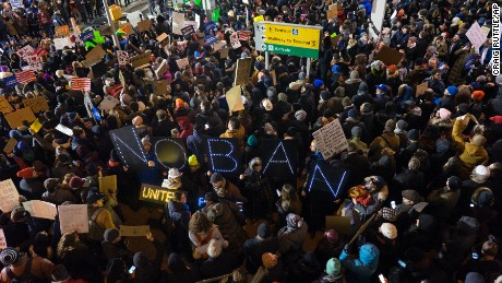 Protesters assemble at John F. Kennedy International Airport in New York, Saturday, Jan. 28, 2017, after earlier in the day two Iraqi refugees were detained while trying to enter the country. On Friday, Jan. 27, President Donald Trump signed an executive order suspending all immigration from countries with terrorism concerns for 90 days. Countries included in the ban are Iraq, Syria, Iran, Sudan, Libya, Somalia and Yemen, which are all Muslim-majority nations. (AP Photo/Craig Ruttle)