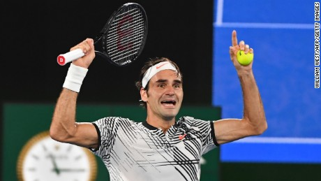 Switzerland's Roger Federer celebrates his victory against Spain's Rafael Nadal during the men's singles final on day 14 of the Australian Open tennis tournament in Melbourne on January 29, 2017.