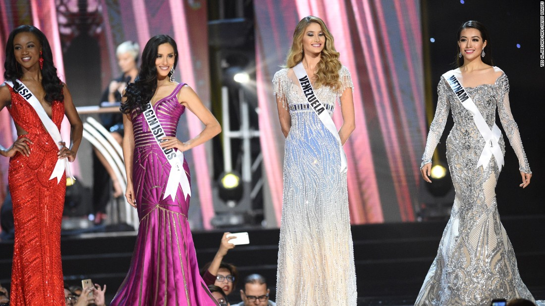 Miss Universe contestant Le Hang (R) of Vietnam in her long gown along with other candidates during the preliminary competition of the Miss Universe pageant.