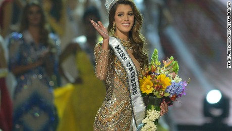 Miss Universe candidate Iris Mittenaere of France waves to the audience after winning the title in the Miss Universe pageant at the Mall of Asia Arena in Manila on January 30, 2017. Miss France was crowned Miss Universe on January 30 in a glitzy spectacle free of last year's dramatic mix-up but with a dash of political controversy as finalists touched on migration and other hot-button global issues. / AFP / TED ALJIBE        (Photo credit should read TED ALJIBE/AFP/Getty Images)