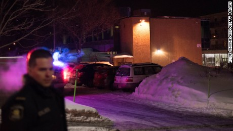 Canadian police officers respond to a shooting in a mosque at the Québec City Islamic cultural center on Sainte-Foy Street in Quebec city on January 29, 2017.