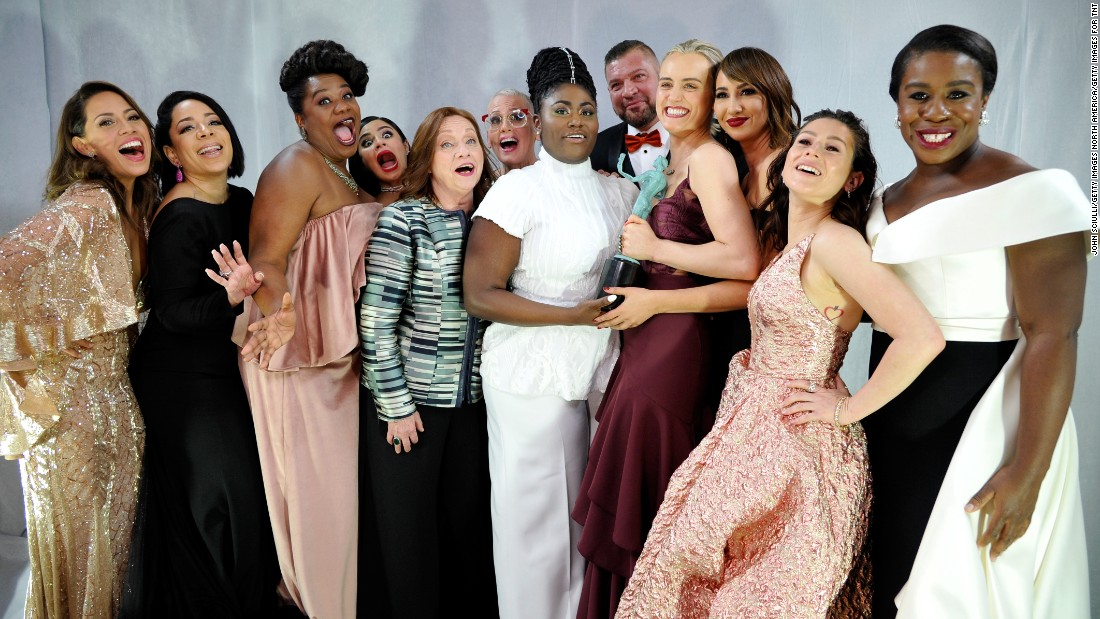 "The cast of ""Orange is the New Black"" celebrates the show's win for outstanding performance by an ensemble in a comedy series backstage."