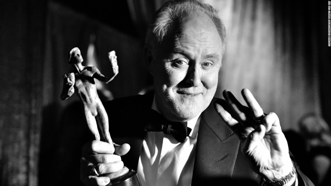 """The Crown"" star John Lithgow celebrates his Screen Actors Guild Award for outstanding performance by an actor in a drama series."