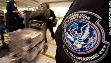 An international air traveler is cleared by a US Customs and Border Protection Officer (L) and is approved to enter the United States inside the US Customs and Immigration area at Dulles International Airport (IAD) , December 21, 2011 in Sterling, Virgina, near Washington, DC.     AFP Photo/Paul J. Richards (Photo credit should read PAUL J. RICHARDS/AFP/Getty Images)