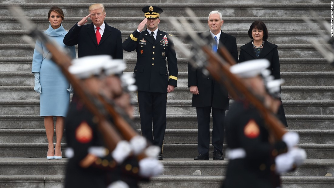 "US President Donald Trump salutes US Marines during his inaugural parade in Washington on Friday, January 20. With Trump, from left, are his wife, Melania; US Army Maj. Gen. Bradley Becker; Vice President Mike Pence; and Pence's wife, Karen. <a href=""http://www.cnn.com/2017/01/20/politics/gallery/donald-trump-inauguration/index.html"" target=""_blank"">See more photos from the inauguration</a>"