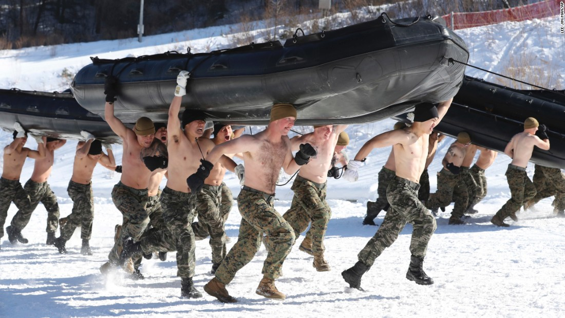 Marines from the United States and South Korea carry inflatable boats during their military exercise in Pyeongchang, South Korea, on Tuesday, January 24.