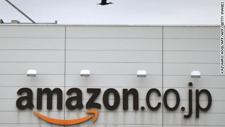 This picture shows a logo of Amazon Japan displayed at the company's distribution centre in Ichikawa, Chiba prefecture on January 24, 2015. Police have raided offices of the Japanese arm of Amazon.com for allegedly letting child pornography to be posted on its website for sale, local media reported.   AFP PHOTO / KAZUHIRO NOGI        (Photo credit should read KAZUHIRO NOGI/AFP/Getty Images)