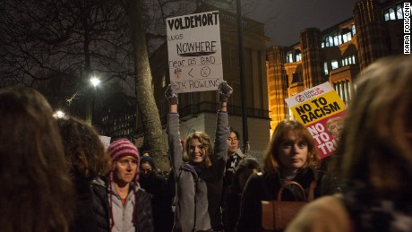 "A Harry Potter fan holds a sign that reads, ""Voldemort was nowhere near as bad,"" during the demonstration."