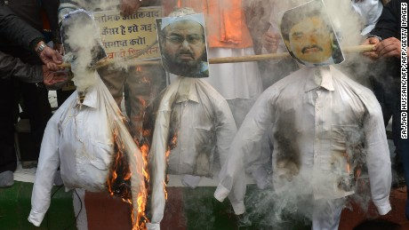 Activists burn an effigy of Hafiz Saeed during a protest in New Delhi on December 21, 2014.
