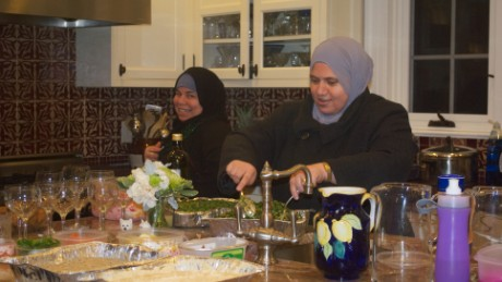 Maryam and Fatimah prepare food in the kitchen before guests arrive.