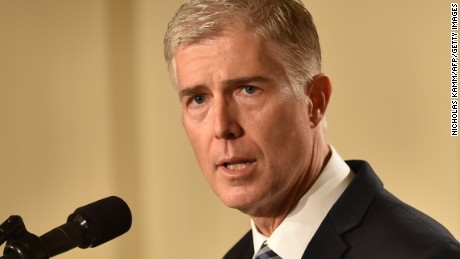 Judge Neil Gorsuch speaks, after US President Donald Trump nominated him for the Supreme Court, at the White House in Washington, DC, on January 31, 2017. President Donald Trump on nominated federal appellate judge Neil Gorsuch as his Supreme Court nominee, tilting the balance of the court back in the conservatives' favor. / AFP / Nicholas Kamm        (Photo credit should read NICHOLAS KAMM/AFP/Getty Images)