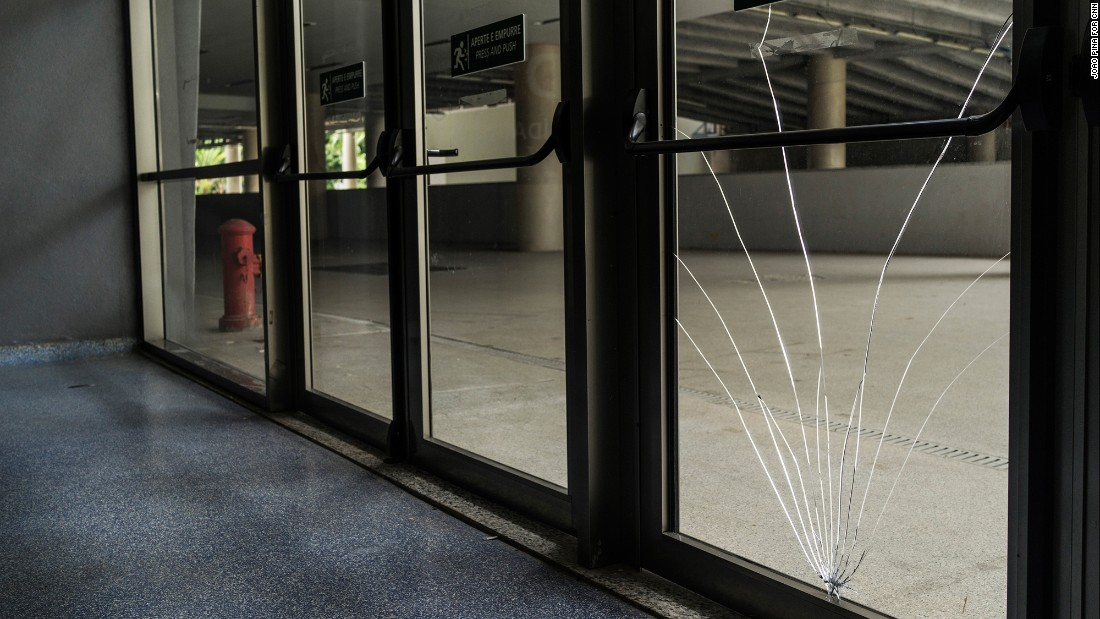 A broken window inside the stadium. Several windows and doors have been broken or damaged.