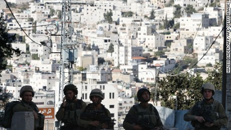 Israeli soldiers stand guard blocking an entrance to the Jewish settlers zone of Hebron's Tel Rumeida neighbourhood, near al-Shuhada street in the city centre of the West Bank town on September 18, 2016, as Israeli security forces closed off access to the area after a Palestinian stabbed an Israeli solider in the area the previous day. / AFP / HAZEM BADER        (Photo credit should read HAZEM BADER/AFP/Getty Images)