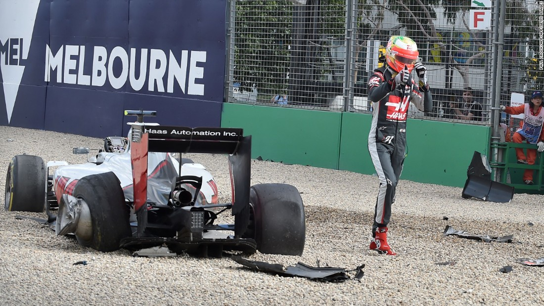 His first weekend with the team in Australia ends with a dramatic crash with Fernando Alonso's McLaren.