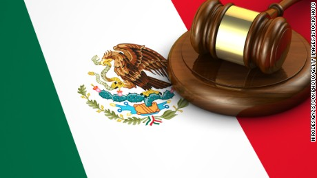 Mexico laws, legal system and justice concept with a 3d render of a gavel and the Mexican flag on background.