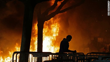 A bonfire set by demonstrators protesting a scheduled speaking appearance by Breitbart News editor Milo Yiannopoulos burns on Sproul Plaza on the University of California at Berkeley campus on Wednesday, Feb. 1, 2017, in Berkeley, Calif. The event was canceled out of safety concerns after protesters hurled smoke bombs, broke windows and started a bonfire. (AP Photo/Ben Margot)
