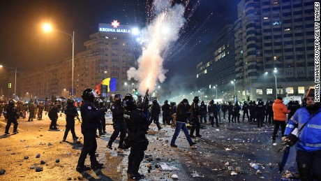 Riot police fire tear gas during protests Wednesday in Bucharest.