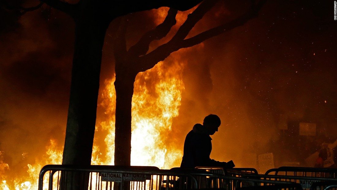 "A fire set by demonstrators protesting a scheduled talk by Breitbart news editor Milo Yiannopoulos burns at the University of California, Berkeley campus on Wednesday, February 1. At least six people were injured during the protest. UC Berkeley <a href=""http://www.cnn.com/2017/02/01/us/milo-yiannopoulos-berkeley/"" target=""_blank"">said ""150 masked agitators"" were responsible for the unrest</a>, adding they came to disturb an otherwise peaceful protest. Administrators decided to cancel the event about two hours before Yiannopoulos' speech."