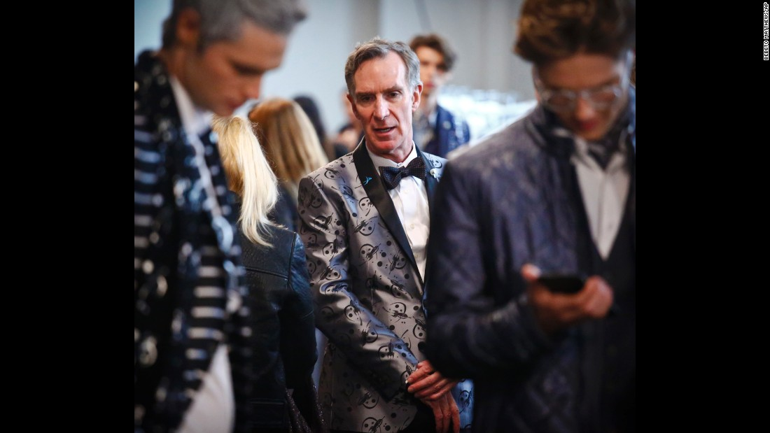 "Bill Nye, center, waits backstage before appearing in the Nick Graham Mars-themed fashion show during Men's Fashion Week in New York on Tuesday, January 31. The science educator and engineer is known for his 1990s hit show ""Bill Nye the Science Guy."""