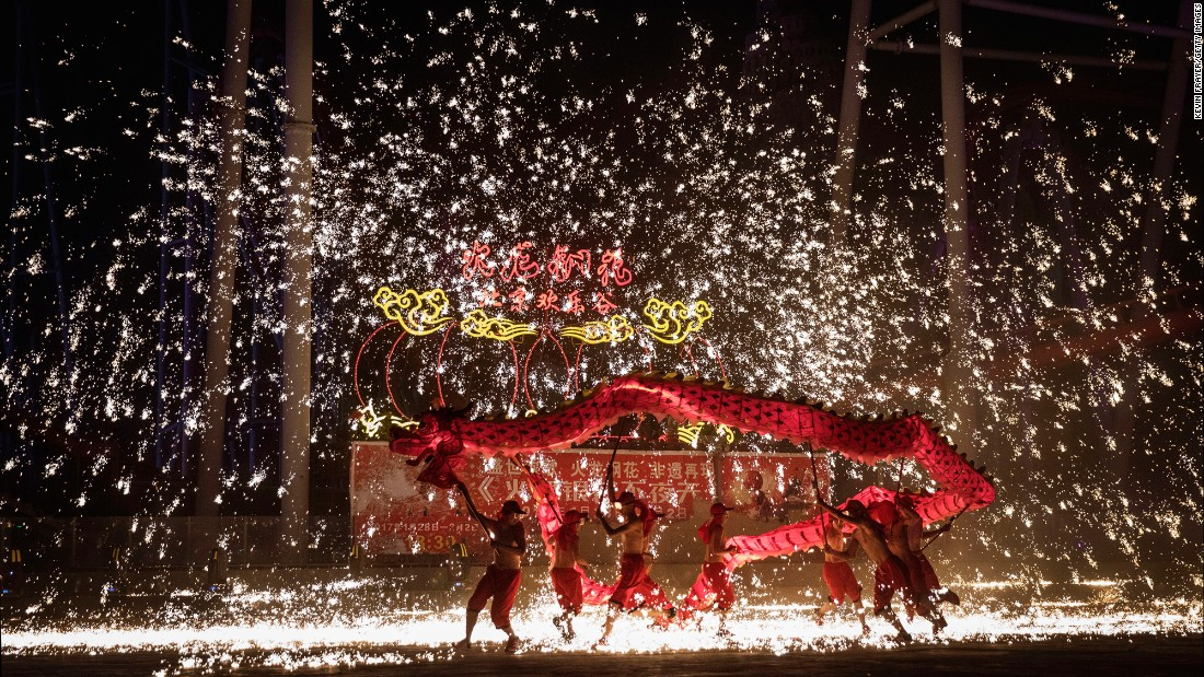 "Sparks fly as Chinese dragon dancers perform at a local park on the fifth day of the Lunar New Year in Beijing on Wednesday, February 1. <a href=""http://edition.cnn.com/2017/01/25/travel/lunar-new-year-etiquette-dos-donts-chinese-new-year/"" target=""_blank"">Lunar New Year</a> is the biggest holiday of the year for many Chinese, with many making trips home to see their loved ones."
