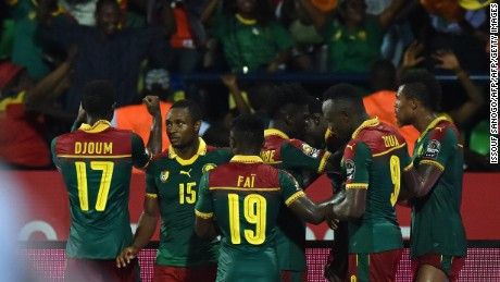 Cameroon's players celebrate after Michael Ngadeu-Ngadjui scored his side's opening goal.
