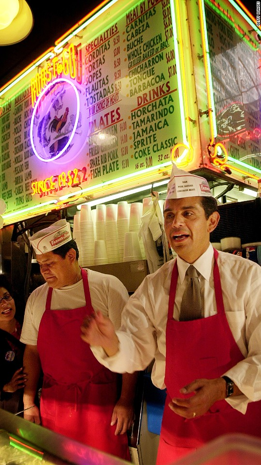 Los Angeles mayoral candidate Antonio Villaraigosa takes orders for tacos in the Grand Central Market on election day, in 2001.
